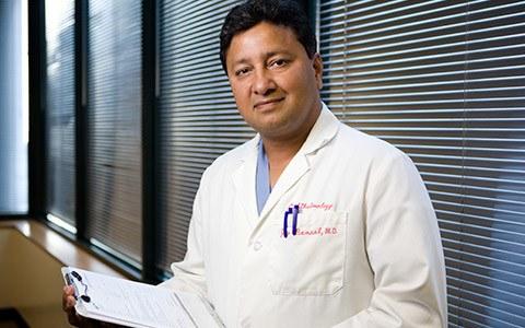 Dr. Jay Bansal w/ Clipboard